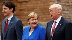 من اليمين: الرئيس الأمكيركي دونالد ترامب والمستشارة الالمانيّة انغيلا ميركل ورئيس الحكومة الكنديّة جوستان ترودو/Jonathan Ernst/Reuters)