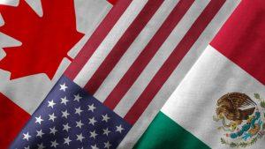من اليسار: أعلام كندا والولايات المتّحدة والمكسيك/ iStock