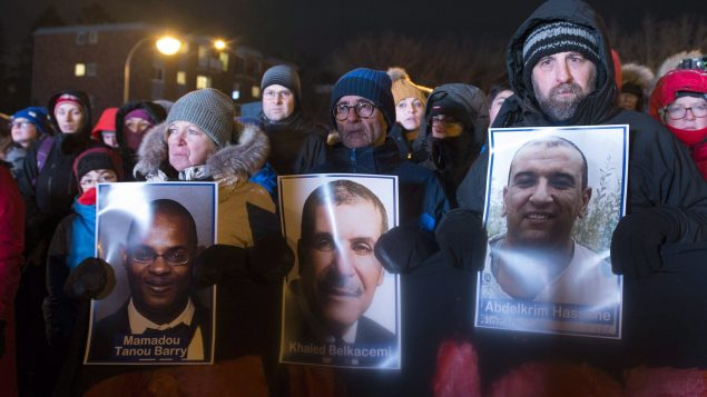مشاركون يحملون صور الضحايا/الصحافة الكندية
