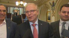 زعيم الحزب الكيبيكي جان فرنسوا ليزيه برفقة اثنين من نواب الحزب/راديو كندا
