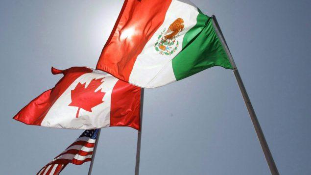 أعلام المكسيك وكندا والولايات المتّحدة ترفرف في نيو اورلينز في 21-04-2018/Judi Bottoni/AP/CP