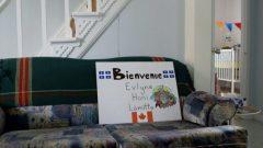 لافتة للترحيب بالعائلة السورية في كيبيك - الصورة : Les vues du fleuve