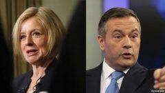 جيسون كيني (إلى اليمين)، زعيم الحزب المحافظ الموحّد وراشيل نوتلي، زعيمة الحزب الديمقراطي الجديد في ألبرتا - Jeff McIntosh and Codie McLachlan The Canadian Press