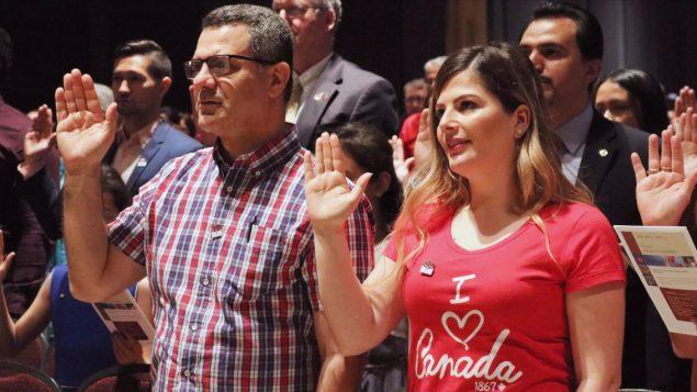 حفل تأدية قسم الجنسية الكندية - The Canadian Press / Adina Bresge