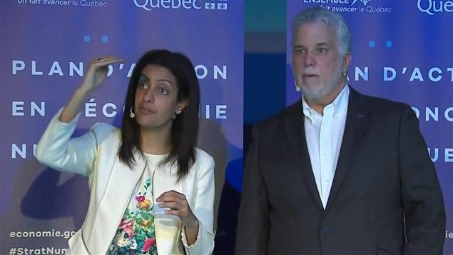 رئيس الحكومة الليبراليّة الكيبيكيّة السابق فيليب كويار ووزيرة الاقتصاد السابقة في حكومته دومينيك أنغلاد/Radio-Canada