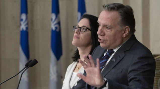 فرانسوا لوغو، رئيس حكومة كيبيك، وصونيا لوبيل، وزيرة العدل في كيبيك - The Canadian Press / Jacques Boissinot