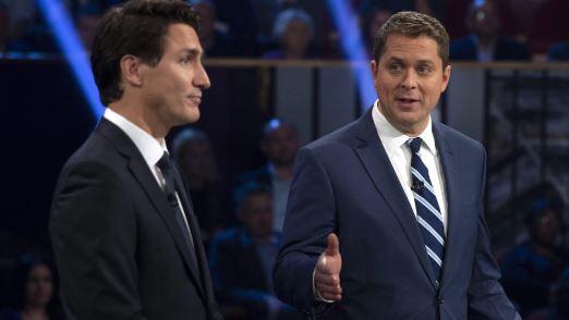 أندرو شير (إلى اليمين)، زعيم حزب المحافطين الكندي هاجم جوستان ترودو حول قضية أس أن سي لافالان - The Canadian Press / Sean Kilpatrick