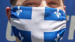 لكي يكون الإجراء فعالا، يجب أن يرتدي 80٪ من السكان الكمّامات - The Canadian Press / Ryan Remiorz