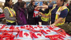 وصول لاجئين سوريين إلى مطار بيرسون في تورونتو في 11 ديسمبر كانون الأول 2015 - The Canadian Press / Nathan Denette