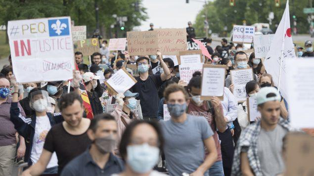 مظاهرة للطلاب صد تغيير برنامج تجربة كيبيك (PEQ) - مونتريال 27 يونيو حزيران 2020 - The Canadian Press / Graham Hughes
