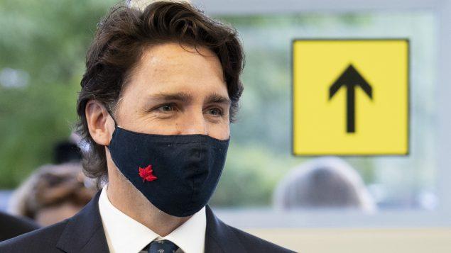 """إذا تمت الإطاحة بحكومته في مجلس العموم بعد خطاب العرش يوم الأربعاء المقبل أو في تصويت آخر ، """"فإن المؤسسات الديمقراطية الكندية قوية بما يكفي لتلبية متطلبات التصويت في وقت الأزمات وإن كان هذا غير مرغوب فيه.""""، كما أوضح جوستان ترودو - The Canadain Press / Adrian Wyld"""