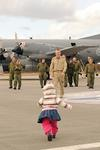 Returning soldier is greeted by his daughter. (Corporal Pamela Evans, Canadian Forces)