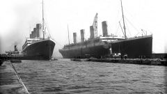 The Titanic (R) has been moved out of the drydock to make way for Olympic which requires repairs. This results in a faterful dealy of Titanic's maiden voyage, from March to April. (Harland & Wolff) CLICK to ENLARGE)