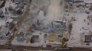 An aerial police photo shows the burned remnants of a seniors' residence that was only partly equipped with a water sprinkler system.Thirty-two residents died in the January 23, 2014 fire. (Photo Credit: Sûreté du Québec)