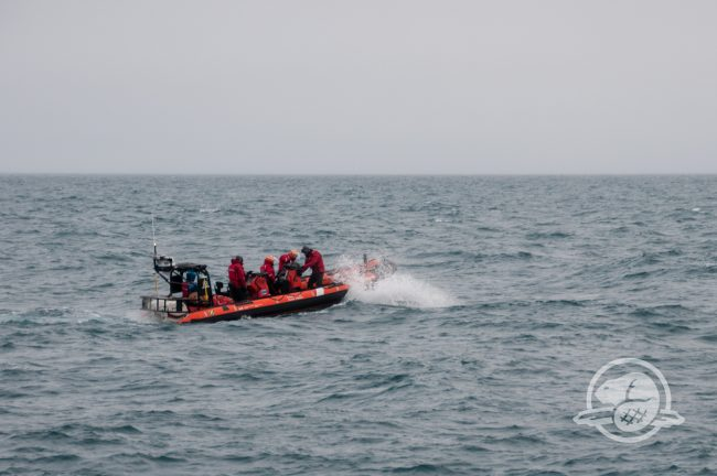 Parks Canada and Canadian Coast Guard personnel make their way towards Terror Bay, Nunavut, to document the wreck with a multi-beam echosounder. (Parks Canada)