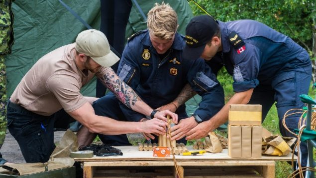 Canadian navy divers prepare explosives used to blow up old naval mines and other old ordnance in the Baltic