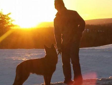 Calvin Kuchta with his dog, Arik