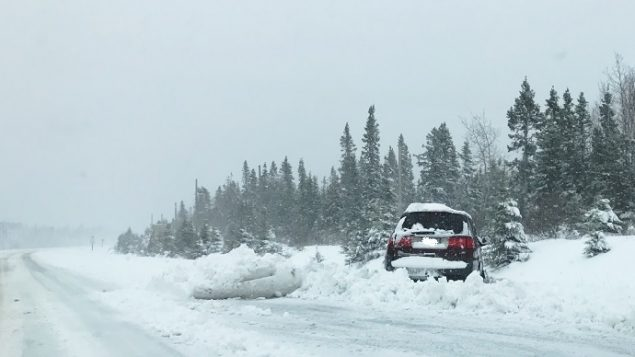 The blizzard with high winds and heavy snow made driving dangerous