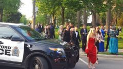 wearing formal dress, theatre goers are evacuated from the grounds of the Festival Theatre in Stratford Ontario