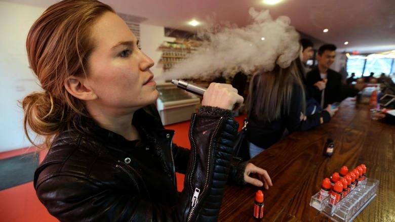 person using e-cigarette.