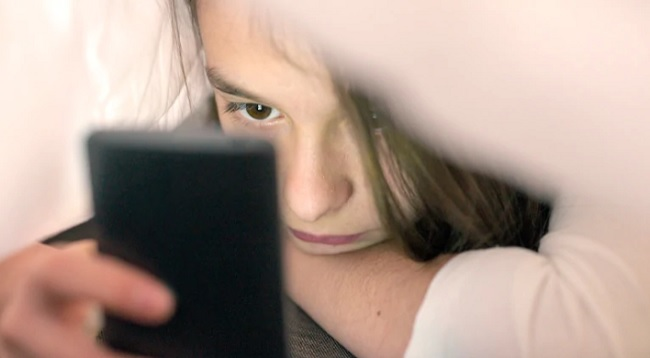 Girl looking at cell phone.