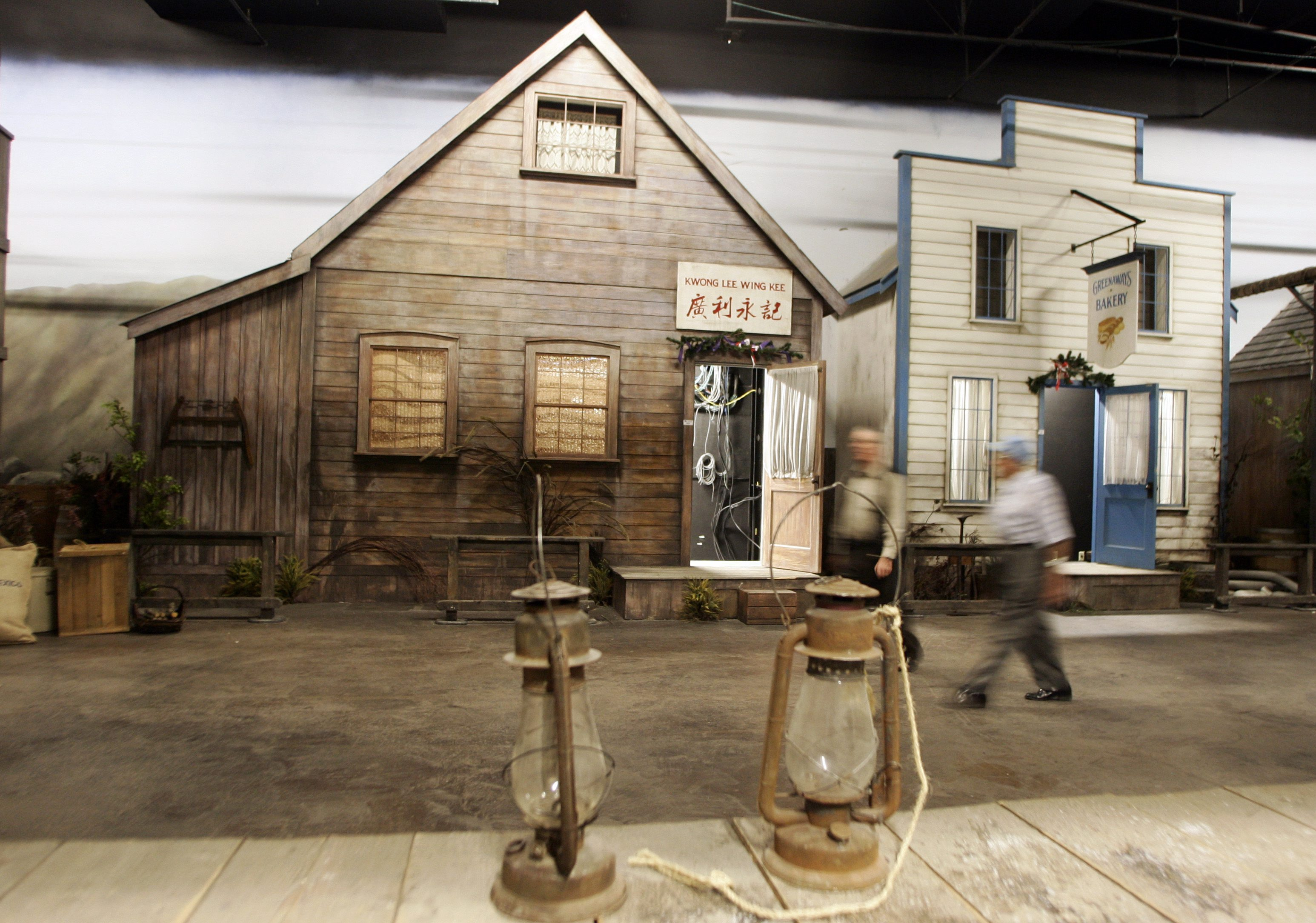 Potential bidders walk through the set of the historical mining town of Barkerville prior to the start of a unreserved auction for all contents of the former Storyeum theatrical museum in Vancouver, Thursday, August 16, 2007. (CP PHOTO/Richard Lam)