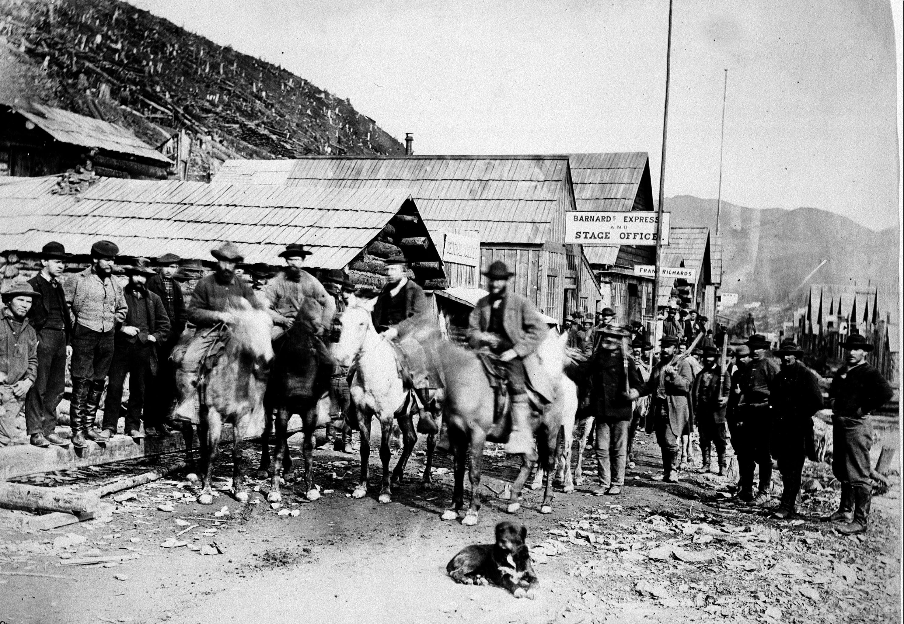 Barkerville British Columbia 1865 Law Enforcement – Security guards. Group of men assembled on Main Street of Barkerville. They are leaving for Cariboo Gold Escort (CP PHOTO) 1999 (Charles Gentile National Archives of Canada)