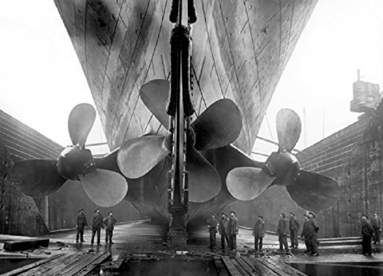 The huge propellers of Titanic. shown compared to workers beneath them . (Harland and Wolff)