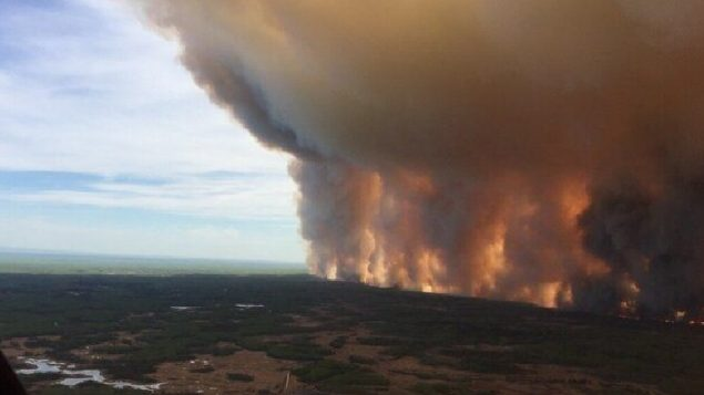 The fire known as the Chuckegg Creek fire is seen from the air in a Government of Alberta handout photo taken near the town of High Level, Alta., Sun. May 19. (Gov't of Alberta-via Canadian Press)
