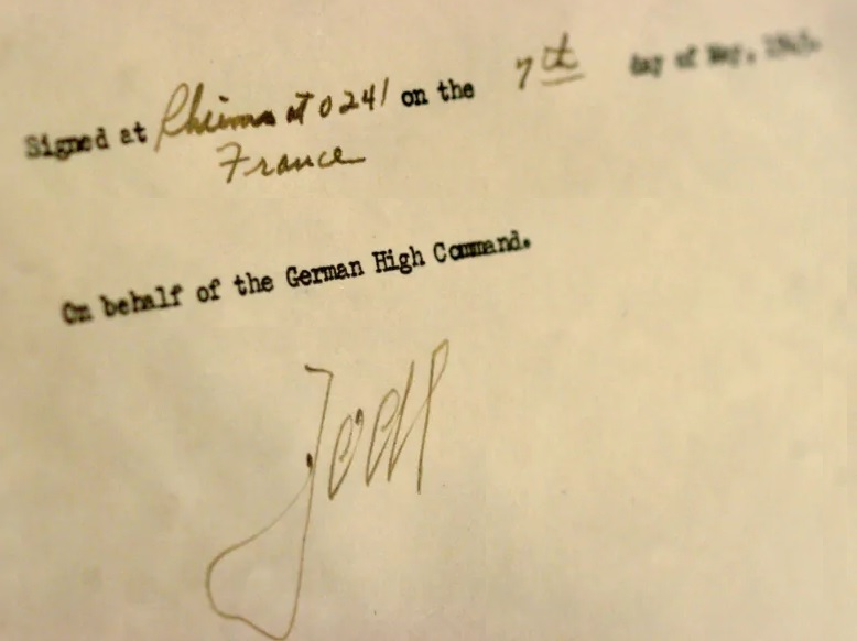 """The signature of German Col. Gen. Alfred Jodl is shown on an original VE Day """"Instrument of Surrender,"""" signed on May 7, 1945, at Allied headquarters in Rheims, France, to end the war in Europe. (Reuters)"""