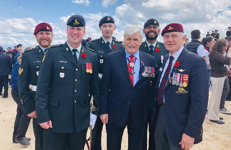 BGen (ret'd) Ernest Beno (right) with the Hon. Romeo Dallaire (centre)- former LtGen and retired Senator. along with members of the artillery group on tour, shown at the ceremony at Juno Beach, Courseulles, June 6, 2019