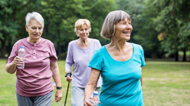 Three senior women walking.