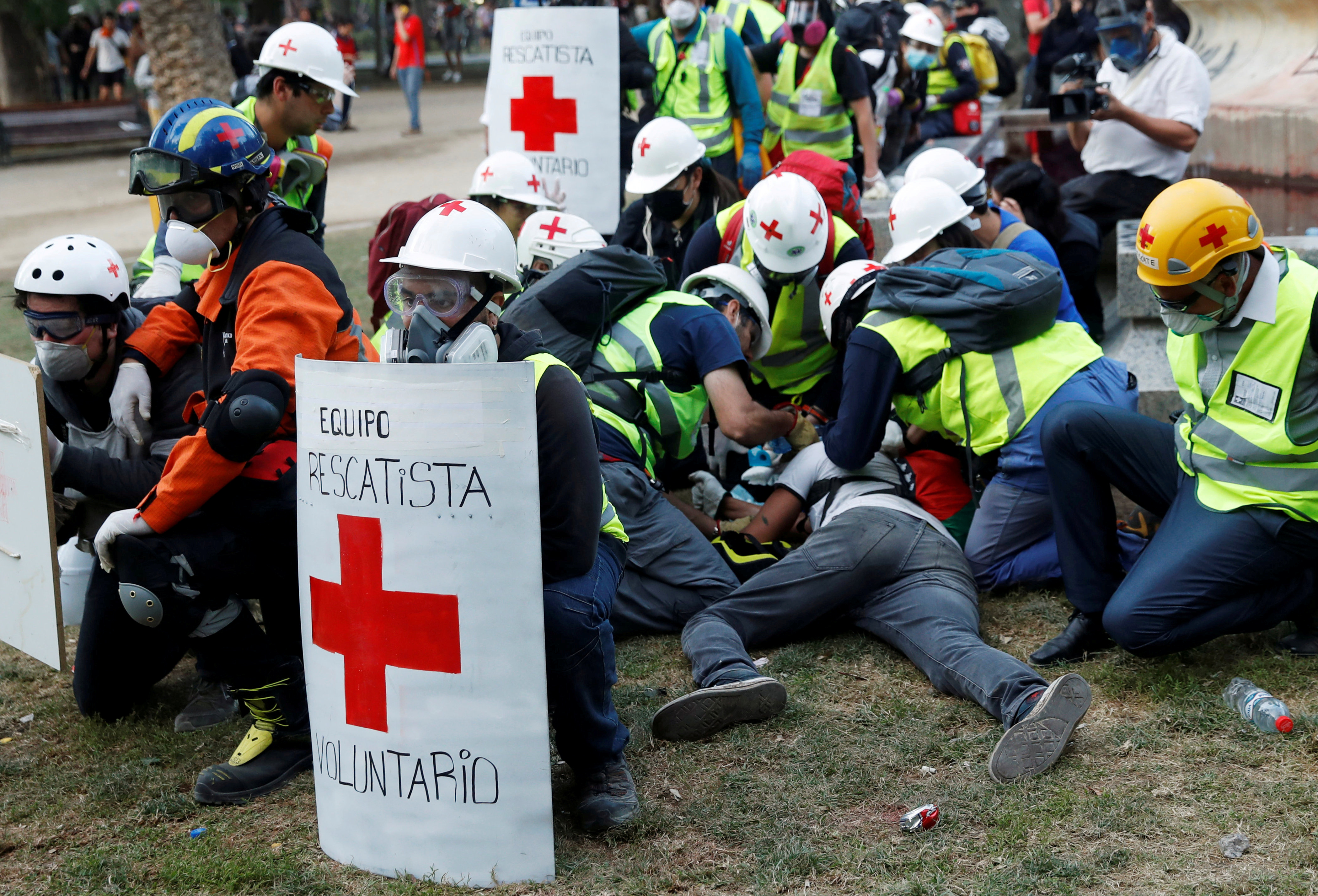 An injured demonstrator is attended to by medical personnel during a protest against Chile's government in Santiago, Chile October 30, 2019. (Jorge Silva/Reuters)
