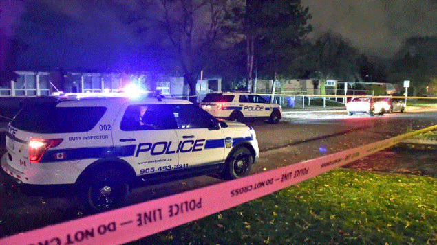 Peel Regional Police cars at the crime scene following a fatal shooting in Brampton