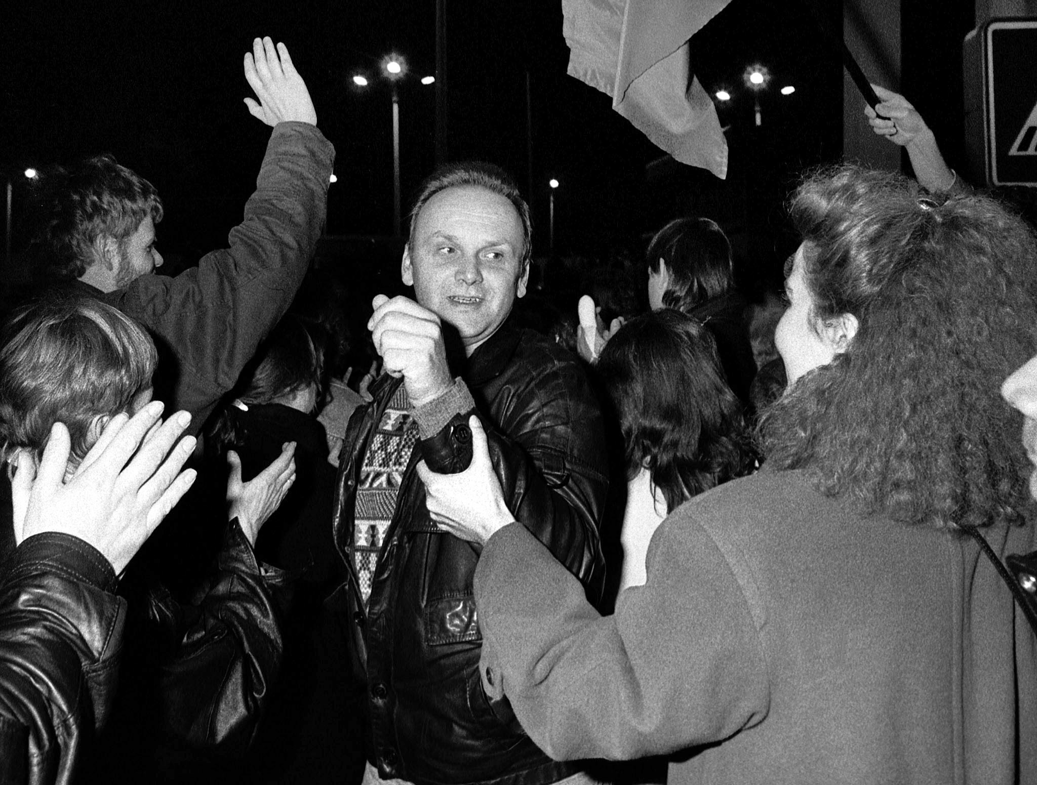 West Berliners welcome an East Berlin citizen crossing the border at the Allied checkpoint Charlie. (Reuters file)