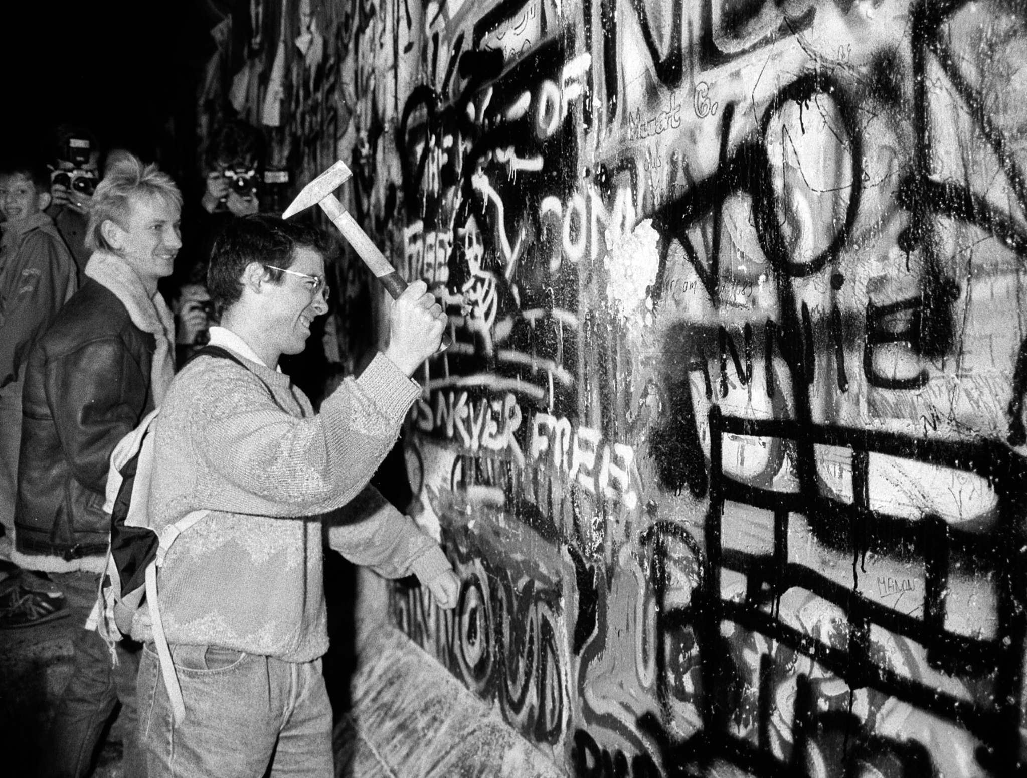 A man hammers a section of the Berlin Wall near the Brandenburg Gate (Reuters file).