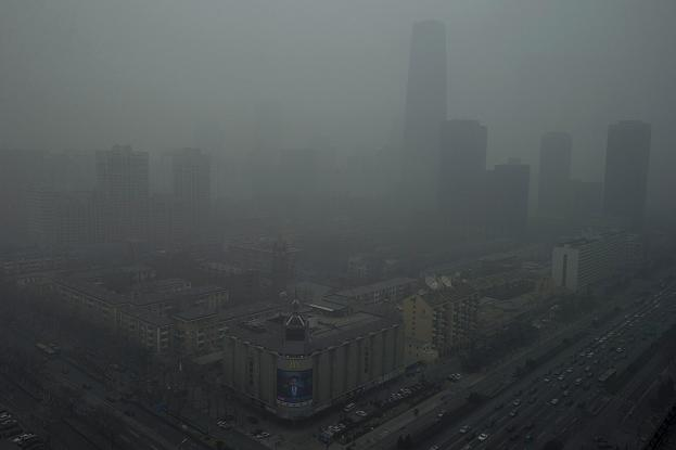 Skyscrapers are obscure by heavy haze in Beijing Sunday, Jan. 13, 2013. Experts are raising concerns about pollution in some parts of Finland. (AP Photo/Ng Han Guan)