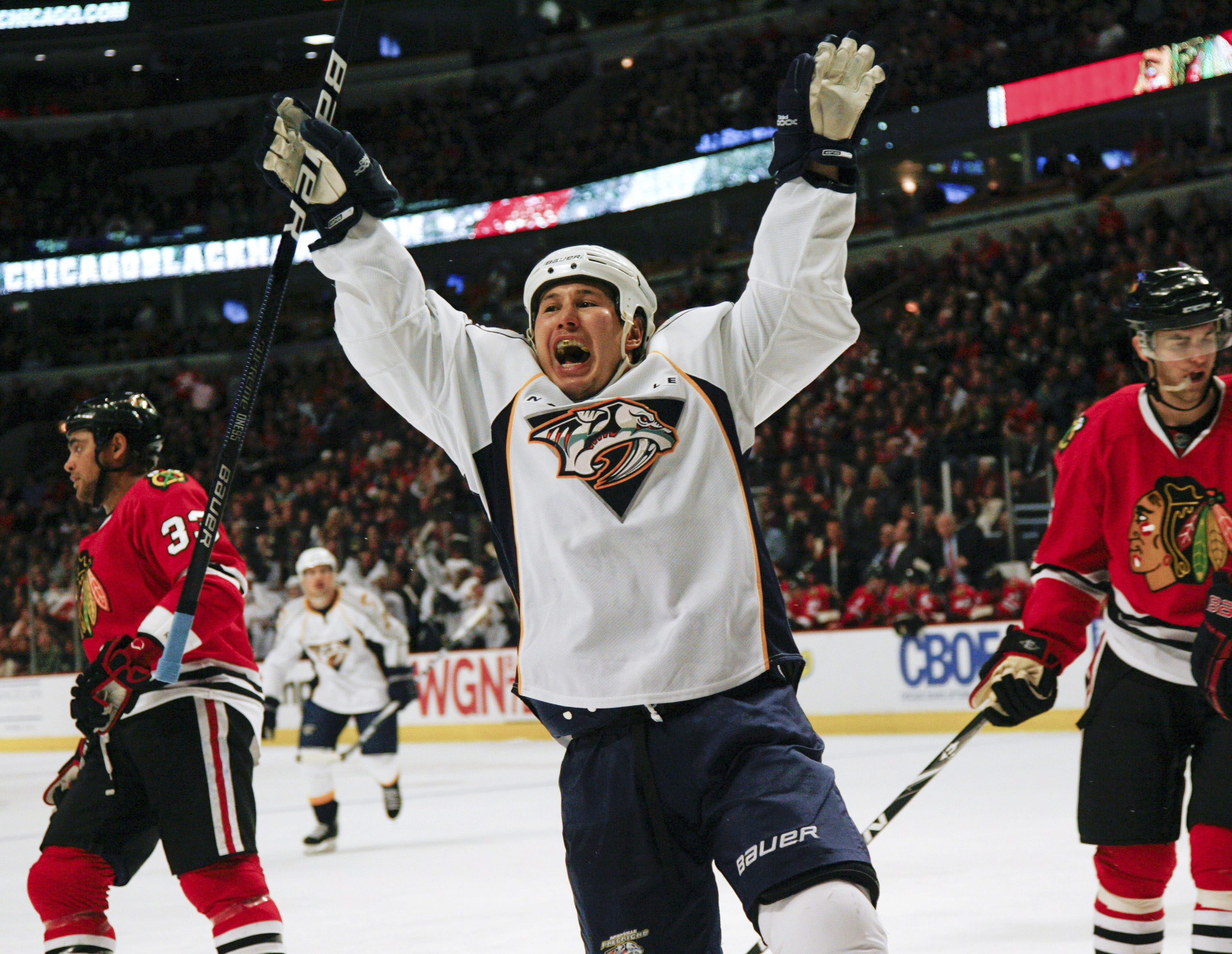 Jordin Tootoo celebrates goal while playing for the Nashville Predators on Friday, Dec. 4, 2009. Photo: Charles Cherney, AP Photo.