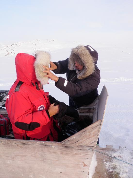 Jaypootie checks Arctic gear of Eye on the Arctic cameraman Alfonse Mondello. Photo by Eilís Quinn.