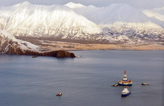 This aerial photo shows the Shell floating drill rig Kulluk in Kodiak Island's Kiliuda Bay on Monday afternoon, Jan. 7, 2013, as salvage teams conduct an in-depth assessment of its seaworthiness. AP Photo/Kodiak Daily Mirror, James Brooks