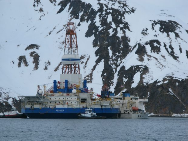 The conical drill rig Kulluk was loaded onto the Chinese heavy-lift vessel Xiang Rui Kou in Captain's Bay, Unalaska on March 19, 2013. (Jim Paulin. Alaska Dispatch)