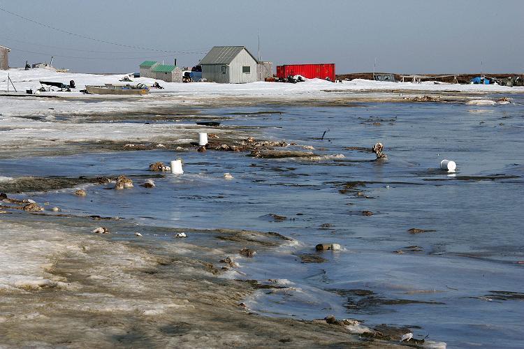 Melting permafrost is erroding land the village of Newtok, Alaska is built on. (AP Photo/Al Grillo)