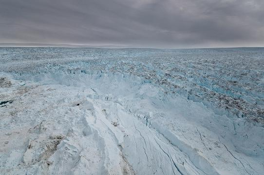 In part because the large Jakobshavn Isbrae moves so quickly, it is difficult to tell the glacier ice (right and top) from the many icebergs it has calbed off (centre front) into the fjord. (Courtesy Ian Joughin / Alaska Dispatch)