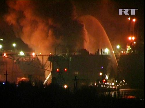 Images released by Russia Today shows fire crew trying to extinguish a fire on board the Russian nuclear submarine Yekaterinburg docked at the closed Roslyakovo military area of the port of Sveromorsk on December 29, 2011. AFP.