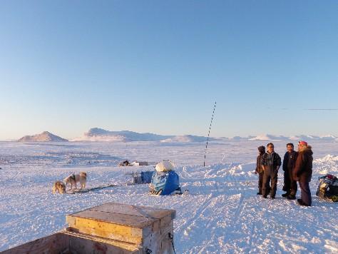 Elijah Palituk chats with hunters at local camp. Photo Eilis Quinn