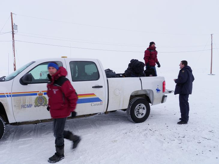 Luc and Jean help load gear into RCMP truck. Photo Eilis Quinn