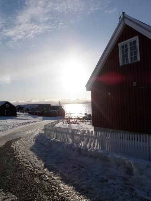 Sun sets in Nuuk's old harbour area. Photo Eilís Quinn
