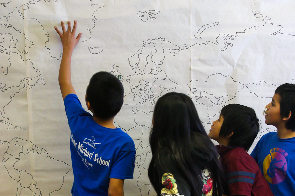 Stony River's Gusty Michael students identify spots on a world map in the lower grades (pre-kindergarten to seventh grade) classrooms. Alex DeMarban photo
