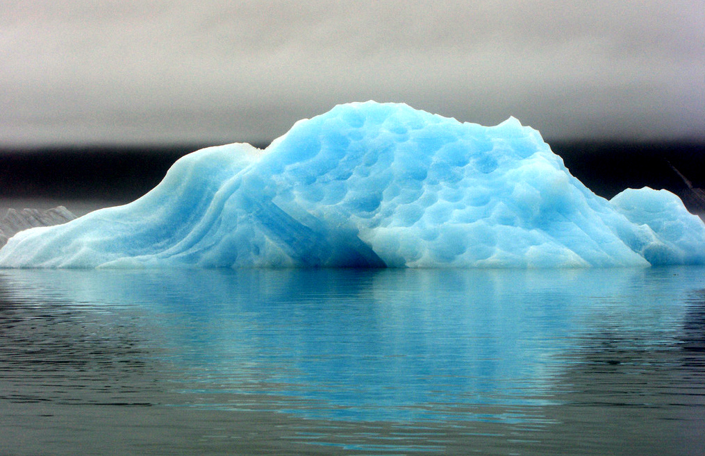 Icebergs floating in Bear Glacier Lake give off an eery, luminous neon blue. One can easily kayak up to this iceberg, which is massive enough to be considered stable. (Eric Adams / Alaska Dispatch)
