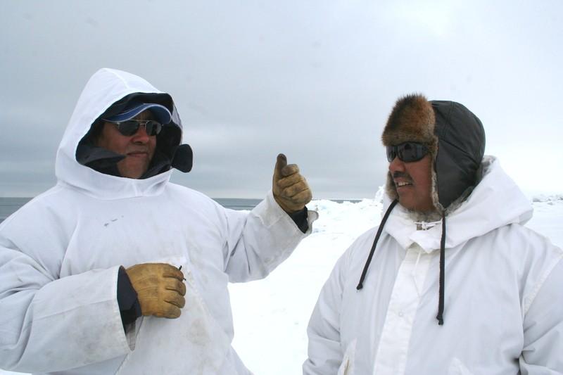 Siku - Inuit - Hila hunters Joe Leavitt and Joelie Sanguya talk on sea ice edge near Barrow, Alaska. Photo courtesy Shari Gearheard